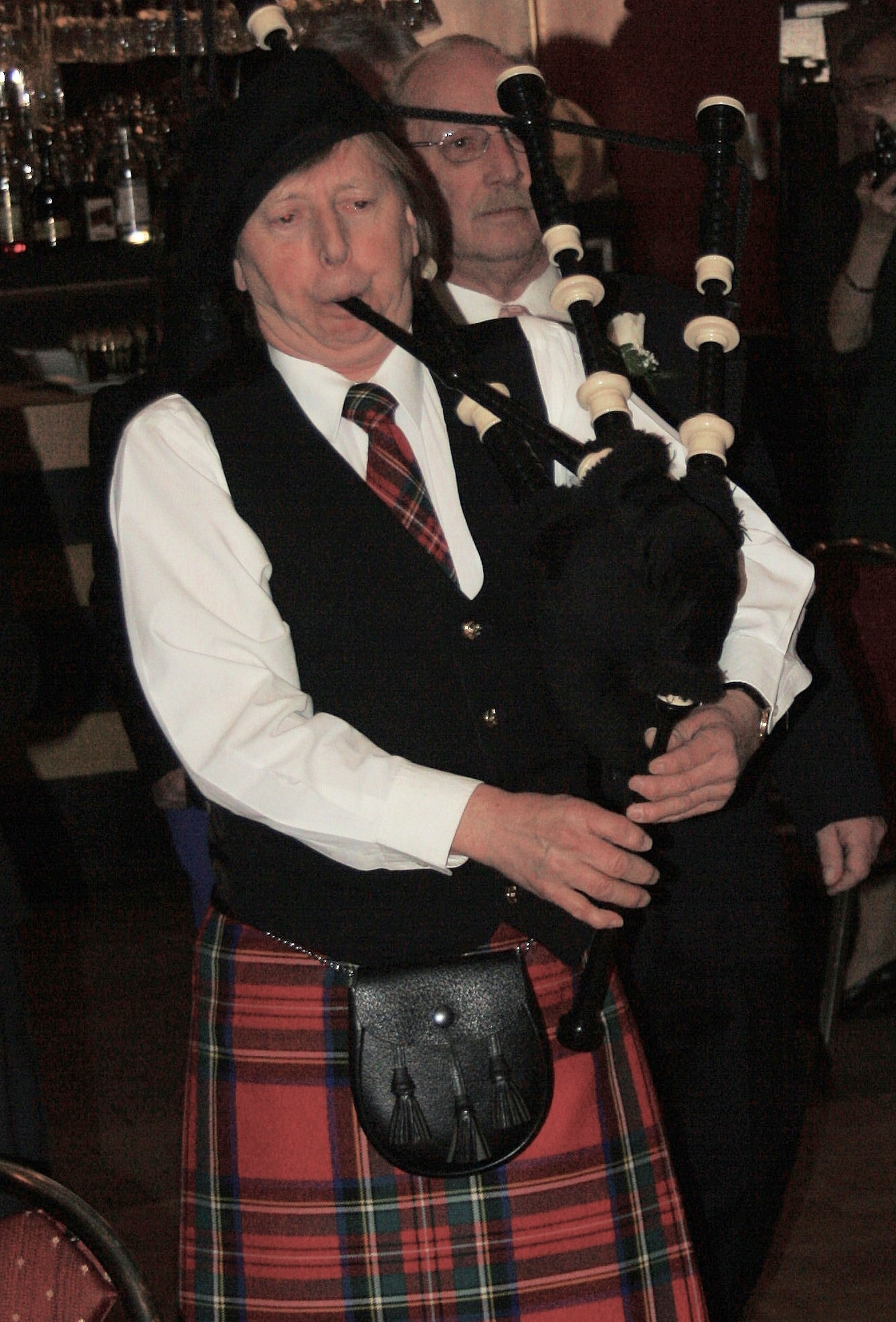 The Champions of Lifelong Learning escorted into Gala by a piper